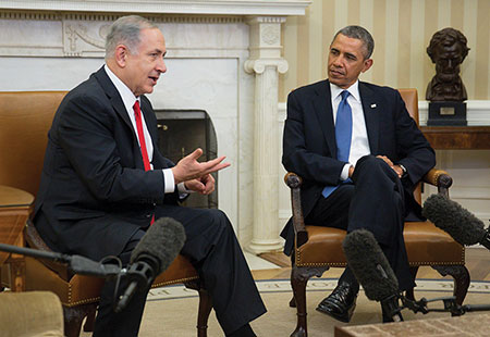 Israel Prime Minister Benjamin Netanyahu (left) sits with President Barack Obama during a meeting in the Oval Office in March 2014. (Andrew Harrer-Pool/Getty Images)