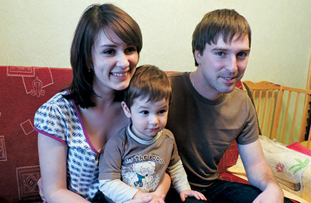 Ilya and Luba Tolkachov and their 22-month-old son live in a tiny one-room Kiev apartment, which they share with with Ilya's mother. (Ben Sales)