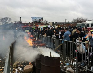 CHAMETZ BURNING: Members of the Jewish community gather at the Pimlico Race Course Clubhouse parking lot on April 3 to burn and donate their chametz before the start of Passover. The event was organized by the City of Baltimore, CHAI, The Associated: Jewish Community Federation of Baltimore and Star-K. (Joshua Runyan)