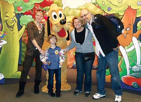 The Shaivitz family poses with Pluto on a family trip to Disney World. (Provided)