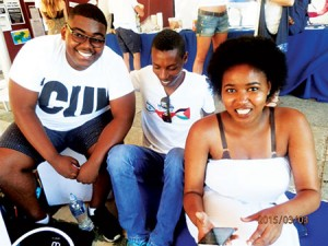 Ethiopian-Israeli Danny Ayanou (center) meets with students during a  Confronting Apartheid event at the University of Cape Town in South Africa.