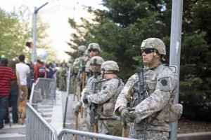 National Guardsmen were stationed behind barricades in front of City Hall.