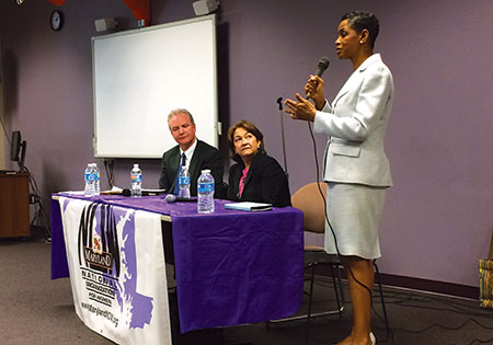 Rep. Chris Van Hollen (left) and Terry O'Neill, NOW president, listen as Rep. Donna Edwards makes a point.