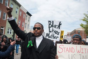 Malik Shabazz, of Black Lawyers for Justice, leads protesters through Baltimore. Many community leaders questioned his motives and presence in the city. (NOAH SCIALOM/EPA/Newscom)