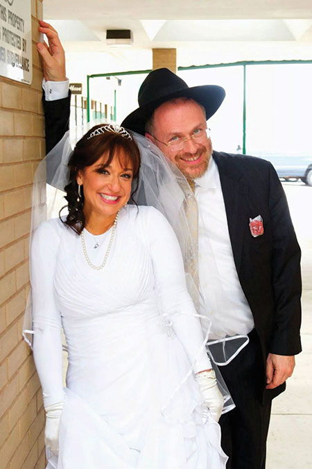 Chayim Lando and his third wife, Lea Sternbach. Lando has 19  children and stepchildren between the ages of 5 and 28 from his three marriages.