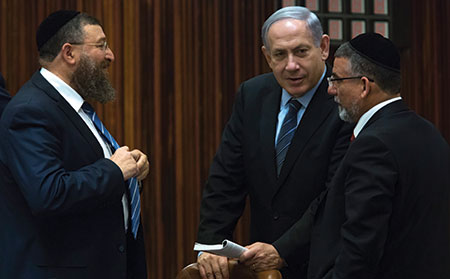 Israeli Prime Minister Benjamin Netanyahu meets with haredi Orthodox Knesset  members, in the rear of the parliament in Jerusalem last week. (JIM HOLLANDER/EPA/Newscom)