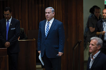 Israeli Prime Minister Benjamin  Netanyahu, shown in the Knesset on May 4, managed to form a ruling coalition just 90 minutes before the deadline.  (Miriam Alster/Flash90)