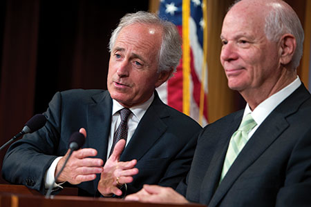 Sens. Bob Corker (R-Tenn.), left, joins Ben Cardin (D-Md.)  at a news conference in the Capitol's Senate studio after the chamber passed the Iran Nuclear Review Act. (Tom Williams/CQ Roll Call/Newscom)