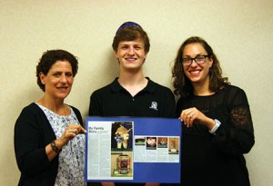 Beth Tfiloh eighth-grader Eitan Murinson presents his project with Jewish Museum of Maryland education director Ilene Dackman-Alon (left) and teacher Lizabeth Shrier. (Rina Goloskov)