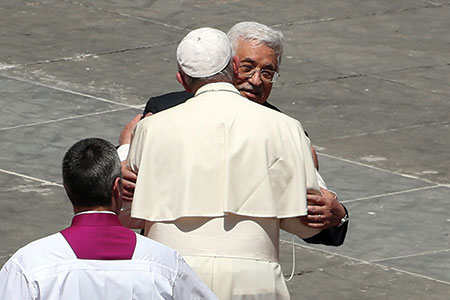 Pope Francis greets Palestinian  Authority President Mahmoud  Abbas as the pope leaves St. Peter's  Square at the end of a canonization  ceremony in Vatican City last month.