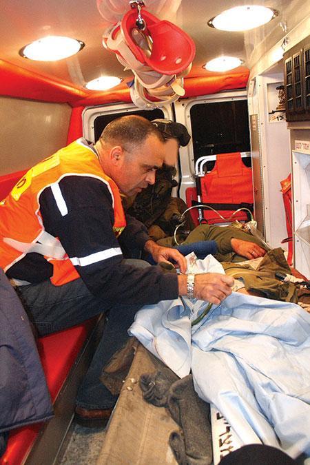 Medics attend to an injured Israeli inside a MDA ambulance.