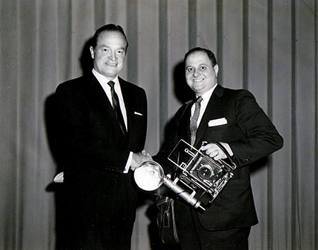 Jerry Esterson, above, with  Bob Hope and at right, with  his wife, Lois, and bandleader Mitch Miller. Esterson spent nearly six decades as  Baltimore's premier event  and celebrity photographer.