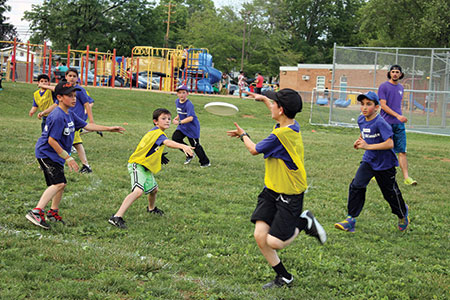Members of the Pikesville Ultimate Disc Association in action during the championship and playoff matches at Wellwood International Elementary School. (Justin Katz)