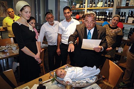 Rabbi Shlomo Riskin, rabbi of the Jewish settlement of Efrat conducts the Pidyon HaBen ceremony for a  30-day-old first-born son in Efrat, West Bank last month. (Gershon Elinson/Flash90)