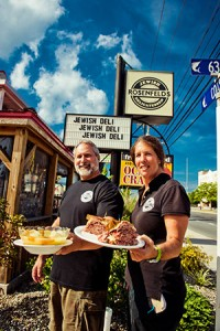 Warren Rosenfeld, owner of Rosenfeld's Jewish Delicatessen in Ocean City, and General Manager Tammy Dubin show off matzoh ball soup and a Reuben sandwich. (Photo by David Stuck)