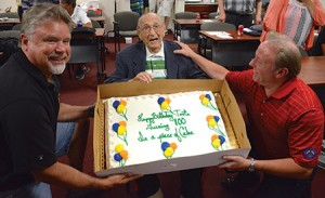 Fred Parsons Jr. (left) and Buddy Bernstein show off the birthday cake to Toots. (Melissa Gerr)