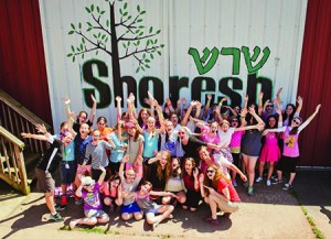 Shoresh Camp Girls of camp getting together in front of the Shoresh sign, painted on barn doors June 24, 2015 Photo David Stuck