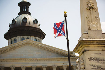 The Confederate battle  flag flies outside the South Carolina State House