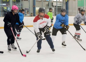 A group of 45 enthusiastic women gather on Sunday nights during the summer to practice their hockey moves and share laughs. (Photos Lacey Johnson)
