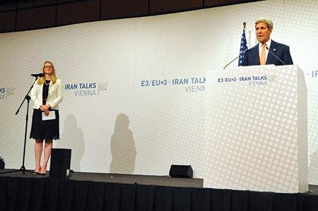 Secretary of State John Kerry, flanked by deputy spokeswoman Marie Harf,  addresses reporters during a news conference last year after two rounds  of talks with his Iranian counterpart. (State Department photo/ Public Domain)