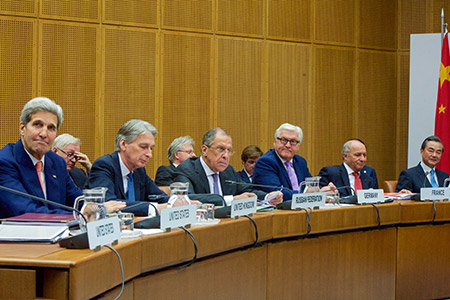 Secretary of State John Kerry (left) sits with British Foreign Secretary Philip Hammond, Russian Foreign Minister Sergey Lavrov, German Foreign Minister Frank-Walter Steinmeier, French Foreign Minister Laurent Fabius and Chinese Foreign Minister Wang Yi, before the final EU and P5+1 ministerial meeting with Iranian Foreign Minister Javad Zarif. (State Department photo/Public Domain)