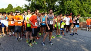 Runners gather at the starting line of the Miles That Matter Pikesville 5K on July 12. The race, which marked its 15th year, raises money for the Ulman Cancer Fund.