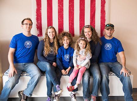From left: Kevin Ralston, Heather Ralston, Mason Tortora, Judith Tortora, with Mya Tortora on her lap, and Jon Tortora.(Provided)