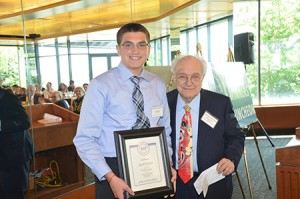 Jacob Witlin receives a certificate from Kaplun Foundation co-chairman Aaron Seligson for his Top 5 finish in the Kaplun essay-writing contest.