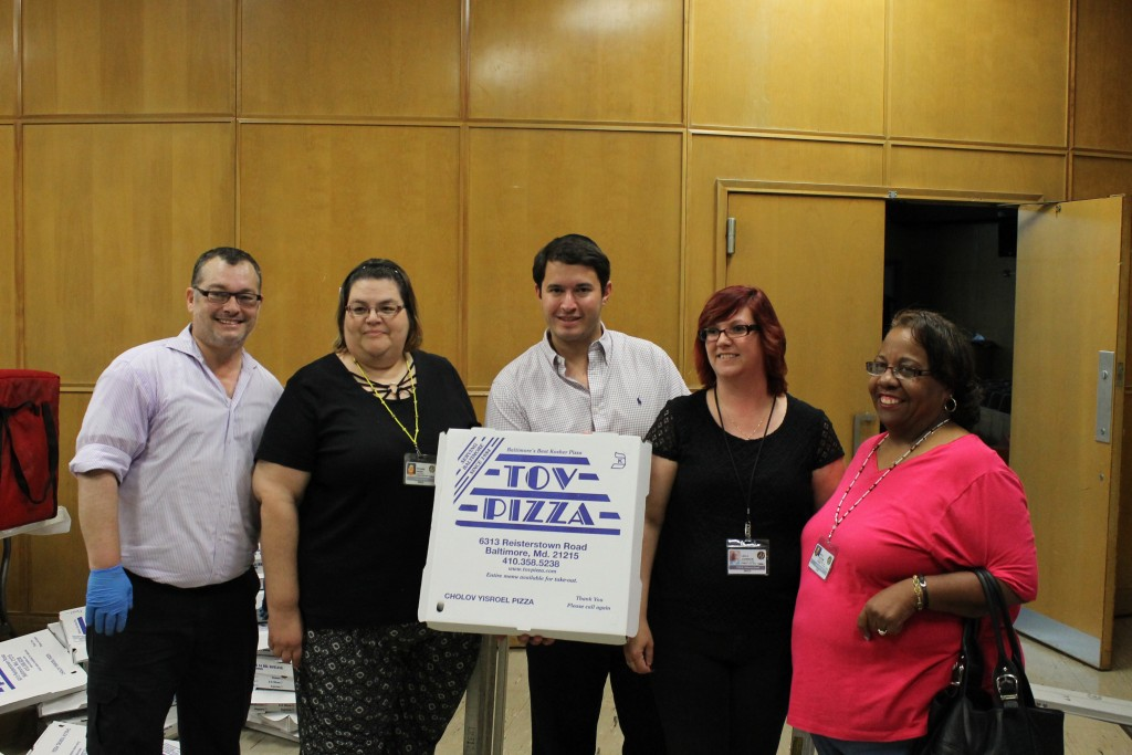 From left: Tov Pizza owner Ronnie Rosenbluth, Roxanne Bagby, event planner Isaac Schleifer, Lisa Johnson and Sally Austin. Bagby, Johnson and Austin are program directors.