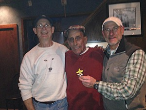 Jerry Sklar stands between former students Lewis Kemper (left) and Gary Levine a few years ago. Inset: Jerry Sklar teaches a photo astronomy class at Pikesville High School in 1972.