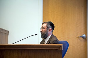Rabbi Velvel Belinsky testifies on Aug. 5 at a Baltimore County Administrative Law hearing over his proposed synagogue.