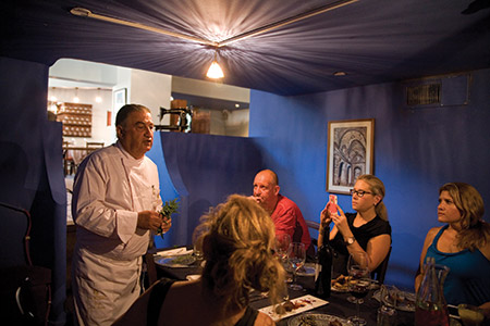 Above: Chef Moshe Basson, known as Israel's Biblical Chef, speaks with a group of journalists at his restaurant, The Eucalyptus. (Photo by Marc Shapiro)