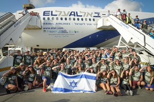 232 new immigrants arrived in Israel with Nefesh B'Nefesh, including 59 men and women who will volunteer for the IDF. The lone soldiers pause for a photo upon landing. (Provided)
