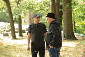 "David Simon (right) talks with  director Paul Haggis on the set  of Simon's new HBO series ""Show Me a Hero."""