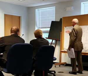 Attorney J. Carroll Holzer (standing) makes an argument against construction of a Chabad synagogue on the 8400 block of Stevenson Road. The hearing took place Aug. 12 in Towson.