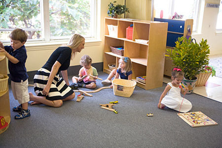 Preschool teacher Leah Zipkin plays with her students on the first day of school at Beth El's new preschool in Federal Hill.