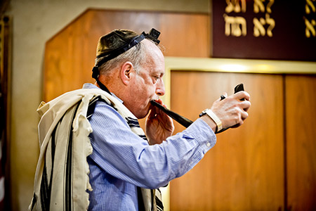 "Men pray at a morning minyan held at Moses Montefiore Anshe Emmunah Hebrew Congregation, a synagogue that uses a traditional dues structure. ""We try to keep things affordable,"" says Jeff Forman, president."
