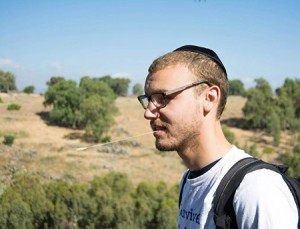 Matt Adelberg, a graduate student at MICA,  was questioned about his views on Israel  and Zionism at Red Emma's bookstore.