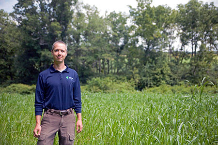 "Greg Strella, farm director at the Pearlstone Center, stands with cover crops Pearlstone planted to replenish its soil during its shmitah year, which Strella says has been a ""rich experience."" (Marc Shapiro)"