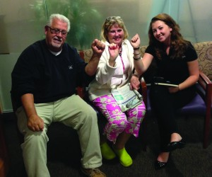 A cancer patient and her husband share a supportive moment with TaketheFight Chief Operating Officer Robyn Lessans (right).