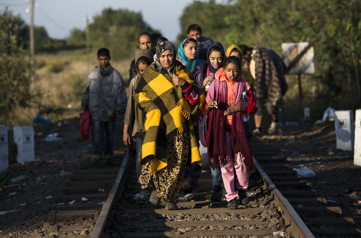 Refugees flee along railroad tracks near the southern Hungarian village of Roszke.