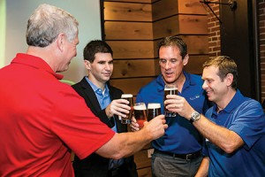 From left: Charlie Storey of Harpoon Brewery and Nadav Efraty, Rick Stover and Francesco Fragasso of Desalitech toast their production of Charles River Pale Ale.