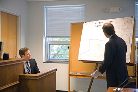 Urban planner Christopher Jakubiak (left) discusses issues with a proposed Stevenson Road synagogue at the sixth Baltimore County hearing over the property. (Marc Shapiro)
