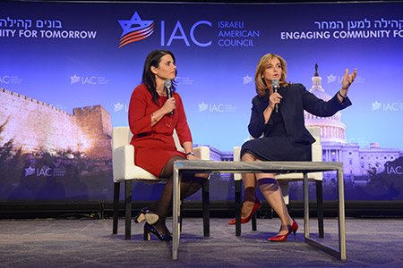 Ayelet Shaked (left), Israel's justice minister, listens as Dana Weiss, an Israeli TV news anchor, speaks at an Israeli American Council event.