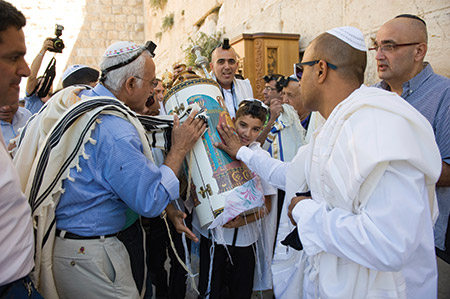 A bar mitzvah at the Kotel in Jerusalem. (©iStockphoto.com/RobertHoetink)