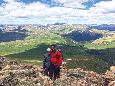 Gail Lipsitz pauses while climbing Mount Bierstadt with her son David. She has resolved to live an active retirement by doing activities such as hiking and traveling. (Photo provided)