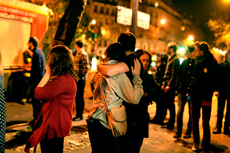 Shocked Parisians gather outside the Bataclan concert hall after the terrorist attacks on Nov. 13. (Pascal Le Segretain/Getty Images)