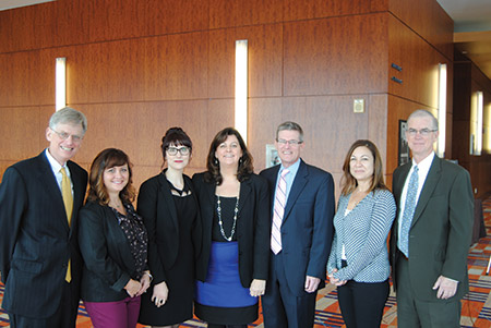 From left: John Corse, associate general counsel for Exelon Corporation; Donna Bossalina, a member of Exelon's legal department; Kristen Strader, daughter of Phyllis and Robert Strader; Phyllis and Robert Strader; and Phyllis Strader's  colleagues, Jennifer DiSciullo and Jack Wood. (Provided)
