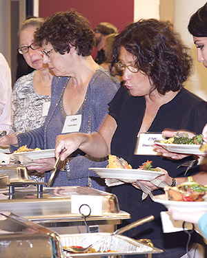 Jewish Veg supporters enjoy vegan food at the organization's 40th anniversary celebration. (Provided)