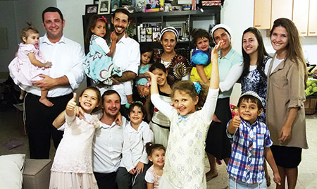 Fabio Erlich (left) and his family join other Brazilian emigres in the Israeli city of Modi'in. (Courtesy of Erlich family)